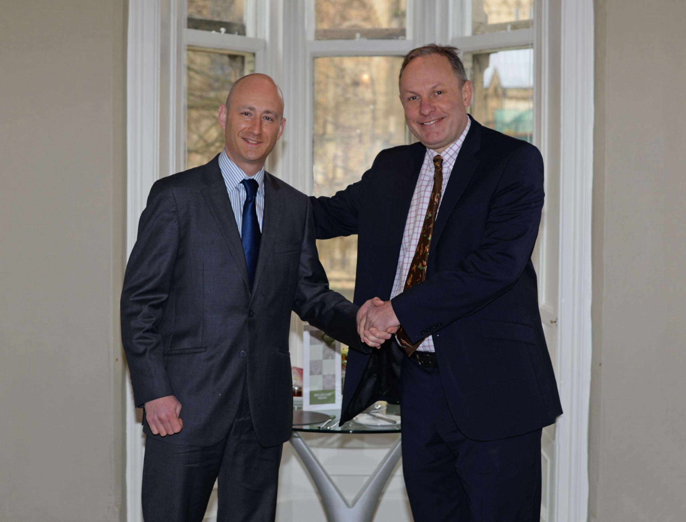 Andrew Lowson, left, being welcomed to the role of York BID executive director by Adam Sinclair, chairman of the BID company