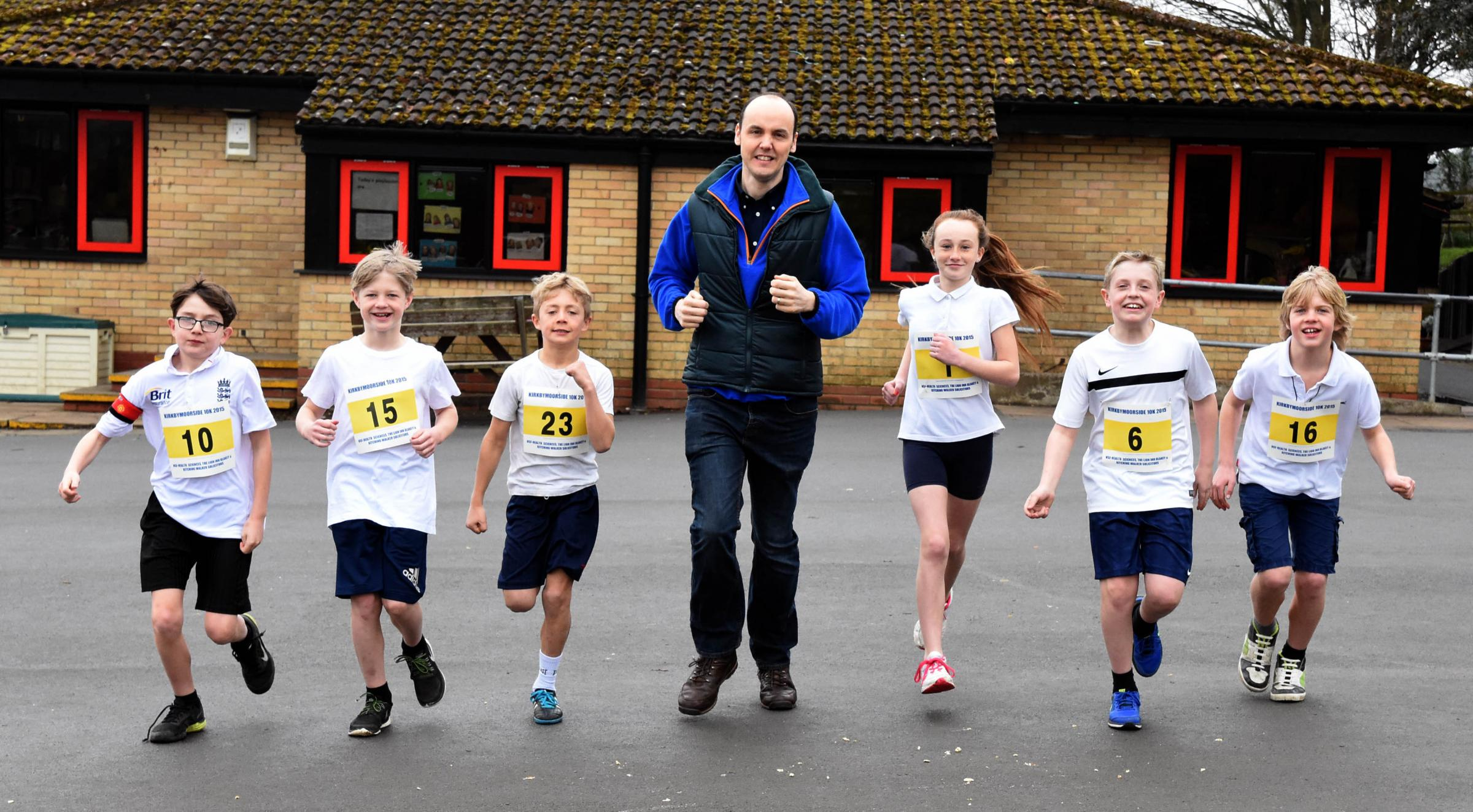 Dave Pearson, Kirkbymoorside 10k race secretary and director, helps pupils at Kirkbymoorside Primary School prepare for annual event in May     Picture: Nigel Holland