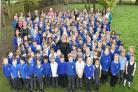 Pupils and Staff celebrate with Sheena Powley at Lord Deramore's  Picture: Frank Dwyer