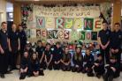 Bootham pupils with the wall hanging