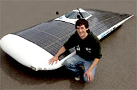 Ex-Bootham School pupil Anthony Law with the solar-powered car he helped to develop with colleagues at Cambridge University