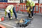 Emergency closure of busy street after hole appears