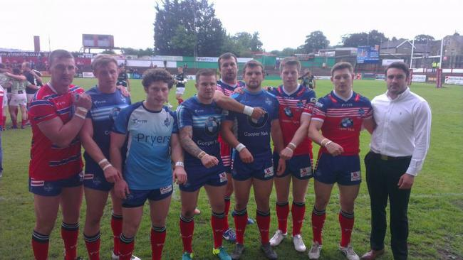 York City Knights players displaying the wristbands worn in honour of long-time fan Colin Brown