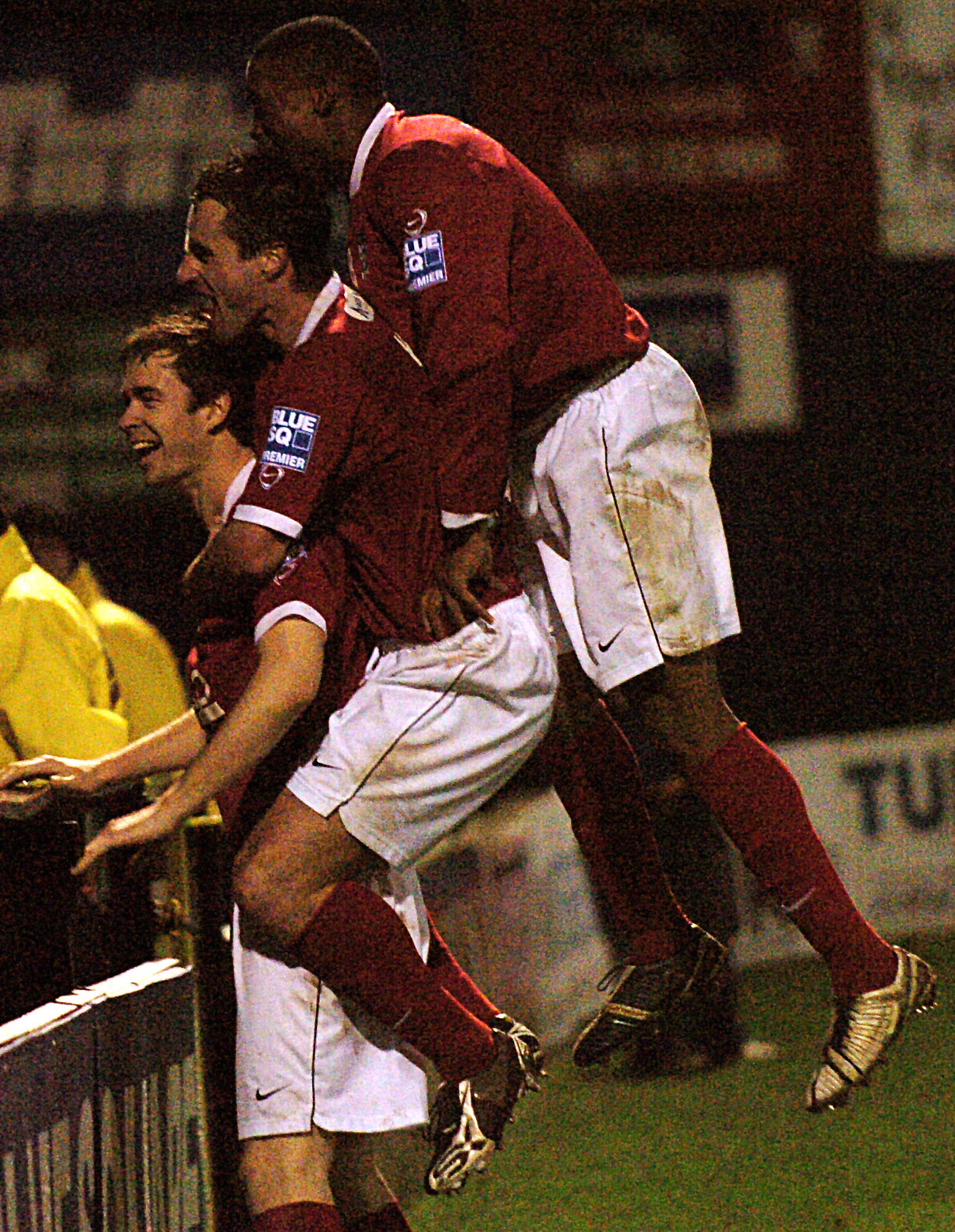 PROVIDING BACK-UP: David McGurk has been appointed assistant-manager at Hyde United by Darren Kelly, who is pictured jumping on his former York City team-mate as the pair celebrate a goal against Weymouth with Manny Panther