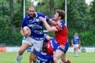 York City Knights' Jonny Presley grappling with Toulouse Olympique's Johnathan Ford