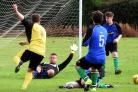 NEAR MISS: Rufforth United's Lee Dutton is denied by goalkeeper Andrzej Dubel during his side's 6-1 victory over Moor Lane in the York Minster Engineering League Division Three. Picture: Nigel Holland
