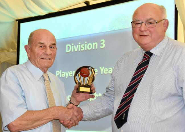 PRIZE: Veteran Geoff Deighton from Retreat II receives the Division 3 Player of The Year Award from Mike Wellock. Picture: David Harrison.