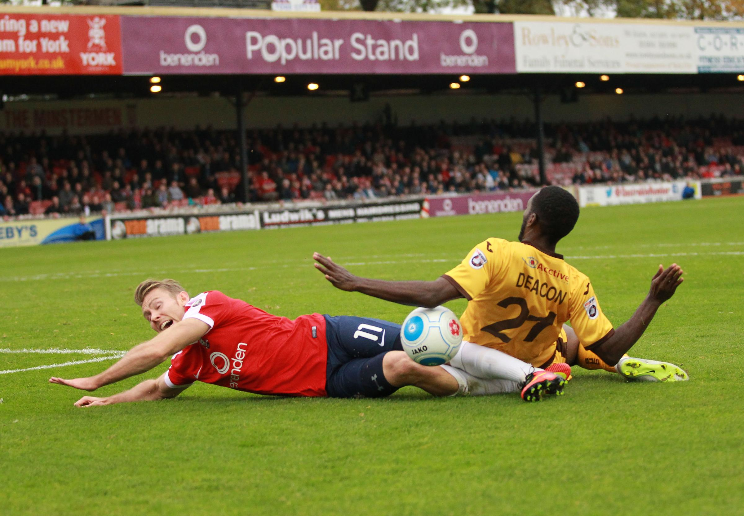 FLOORED: York City attacker Danny Galbraith could not believe he wasn't given a penalty for this challenge by Sutton midfielder Roarie Deacon. Picture: Gordon Clayton