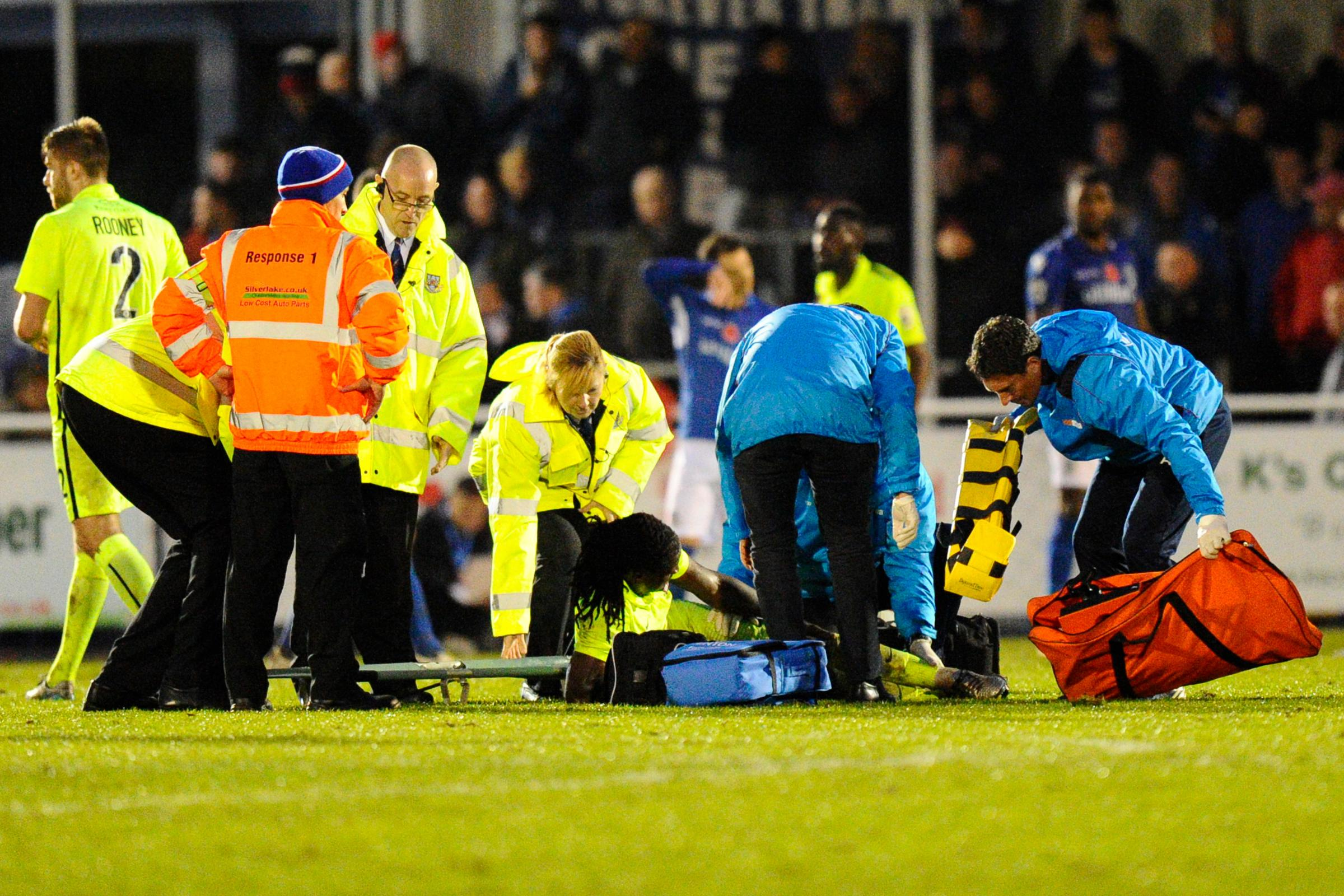 LENGTHY LAY-OFF: Clovis Kamdjo, pictured being treated during Saturday's 1-1 draw at Eastleigh, is facing nine months on the sidelines due to cruciate ligament damage