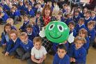 Angela Nickless of the NSPCC with pupils at Lord Deramore's Primary School, York, and Speak Out Stay Safe mascot Buddy