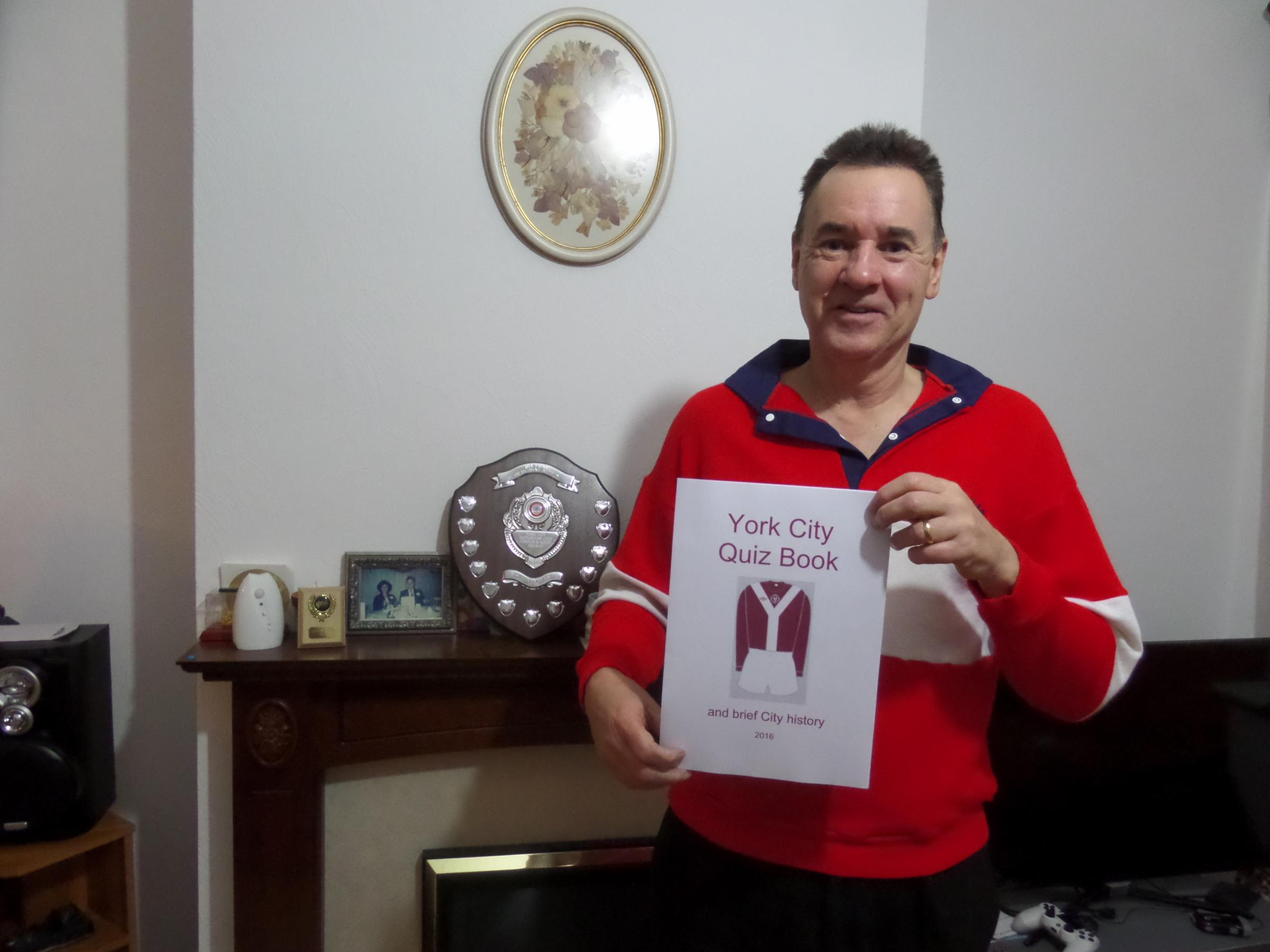 QUESTION TIME: York City South member Chris Forth is pictured with his 2016 York City Quiz Book. It is priced at just £5 and is an ideal Christmas stocking filler for any supporter of the Minstermen