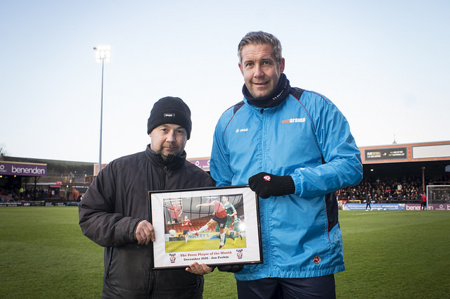 ALWAYS IN THE FRAME: Jon Parkin, pictured receiving his Press Player of the Month award from City supporter Darren Skilbeck, has completed five full matches since his arrival from Newport