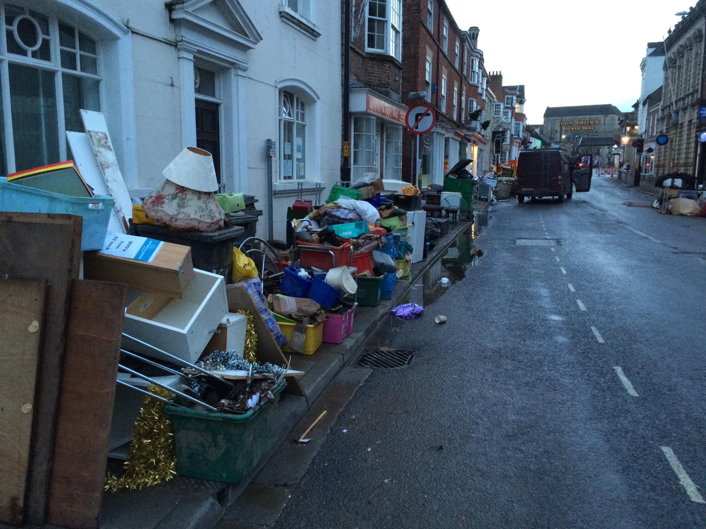 This was the scene in Tadcaster after the December 2015 floods when water-damaged belongings lined the streets. Picture: Dan Bean