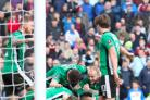 Sean Raggett celebrates scoring Lincoln's winner