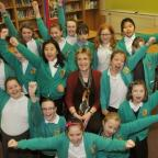 York Press: FLASHBACK: Osbaldwick primary head Lesley Barringer celebrating their Ofsted report with pupils in 2014