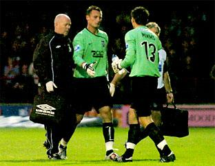 Injured York City 'keeper Artur Krysiak, left, is replaced by substitute Josh Mimms late in the first half of last night's 1-0  victory over Wrexham