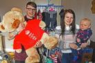 Lauren Collins with baby Freddy and partner Mathew Richards with some of the items that they are selling to help raise money for SCBU.Pic Nigel Holland