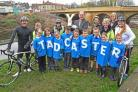 The Tour de Yorkshire trophy with pupils from several primary schools at Tadcaster bridge.Pic Nigel Holland.
