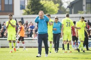 NEEDING FAVOURS: Gary Mills and his players reflect on their situation at the end of the 1-1 draw at Woking. Picture Ian Parker
