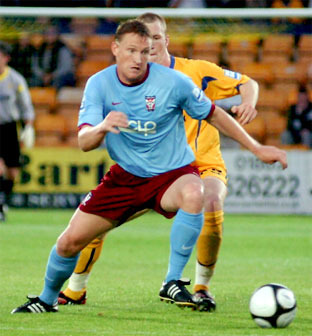 York striker Daniel McBreen gets away from Torquay's Mark Ellis