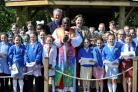 BLESSING: Pictured at St Mary's CE Primary School in Beverley is the Archbishop of York, Dr John Sentamu, with Tesco's David Ryley and head teacher Lucy Jordan. Picture: Darren Casey / DCimaging