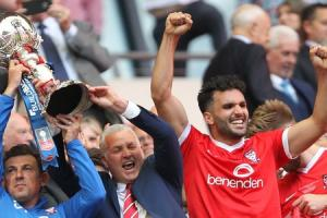York City defender Hamza Bencherif (right) celebrates as manager Gary Mills and assistant Darren Caskey lift the FA Trophy at Wembley. Picture: Gordon Clayton.