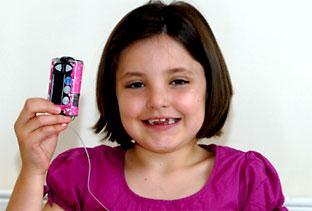 Seven-year-old Ruby Swords, left, holding her insulin pump