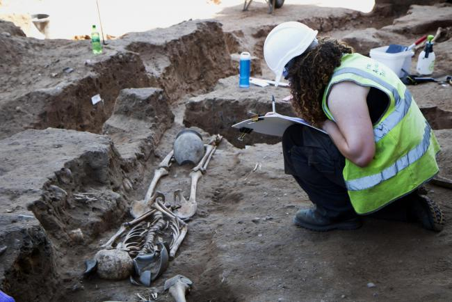 Field archaeologist Becky Wilson makes a detail record of a Roman burial at the former Newington Hotel near Knavesmire Road
