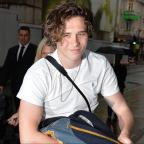 York Press: Brooklyn Beckham supported by parents Victoria and David at book event