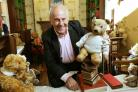 Gyles Brandreth with Dame Judi Dench's  bear in the new library at Newby Hall. Picture: Richard Doughty Photography