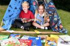 FESTIVAL TENT: Pupils Tyler and Isla, both aged 5, enjoying the reading festival at St Lawrence's Primary in York   Picture Frank Dwyer