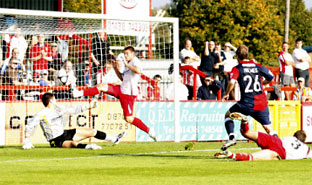 On-loan midfielder Peter Holmes equalises for York City at Stevenage