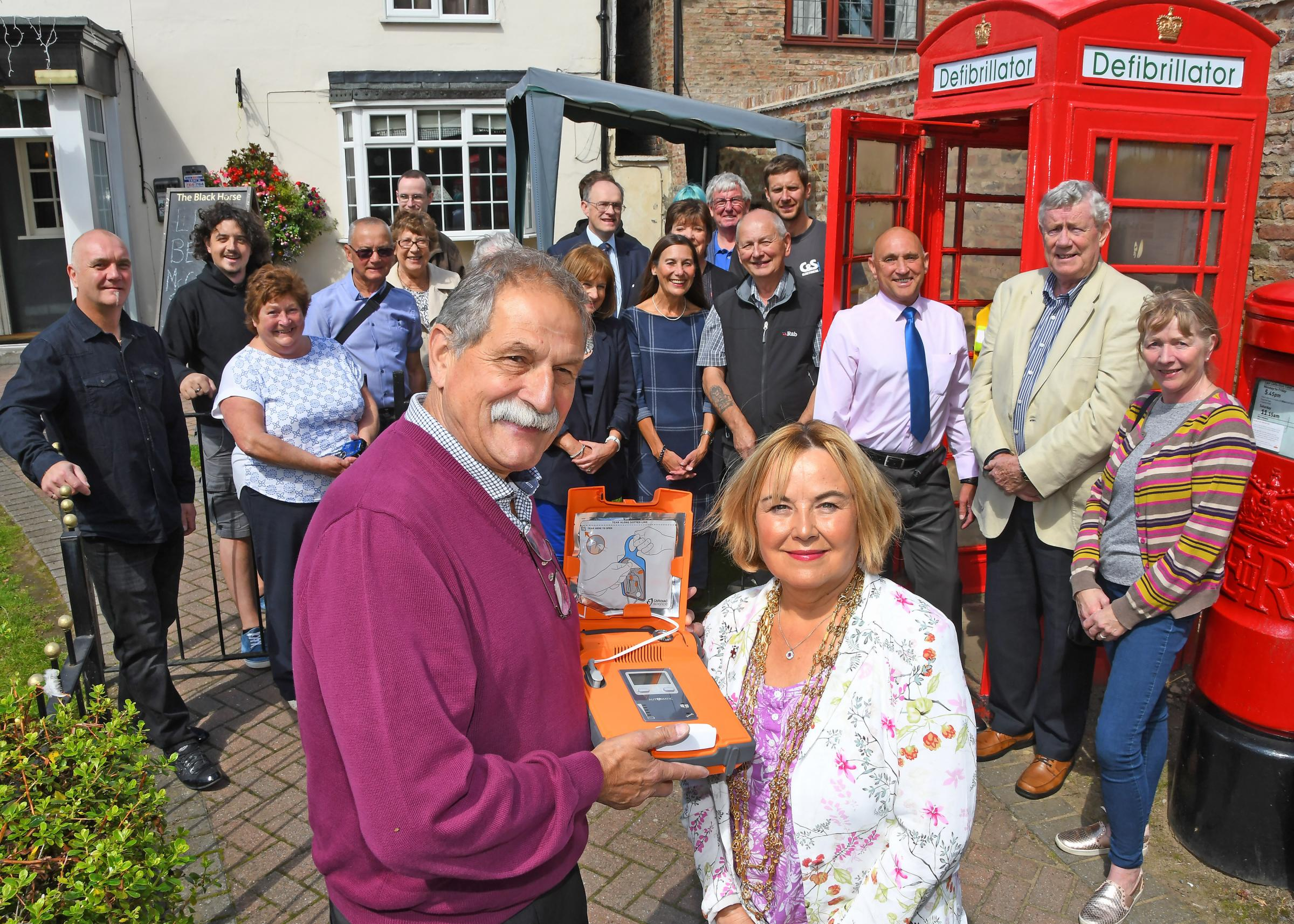 Lord Mayor of York Cllr Barbara Boyce joined David Geary Wiggington Clerk and community members with the new village defibrillator in the old telephone box outside the Blak Horse Pub. Picture David Harrison.