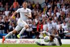 Burnley have signed striker Chris Wood from Leeds for a club-record fee, the Premier League club have announced
