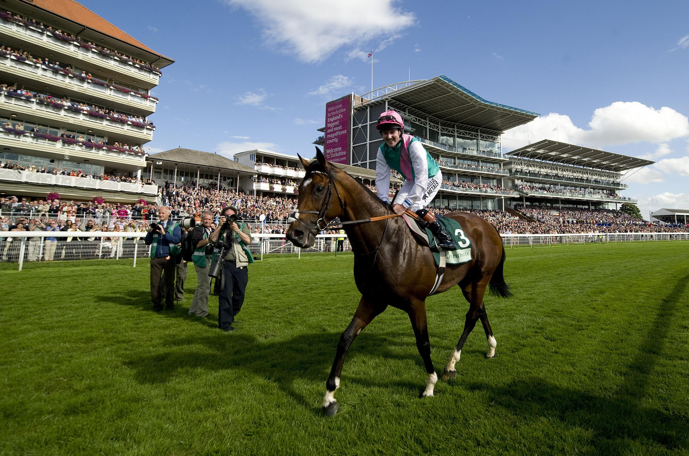 Tom Queally smiles after riding Frankel to victory in the 2012 Juddmonte International Stakes at York Racecourse