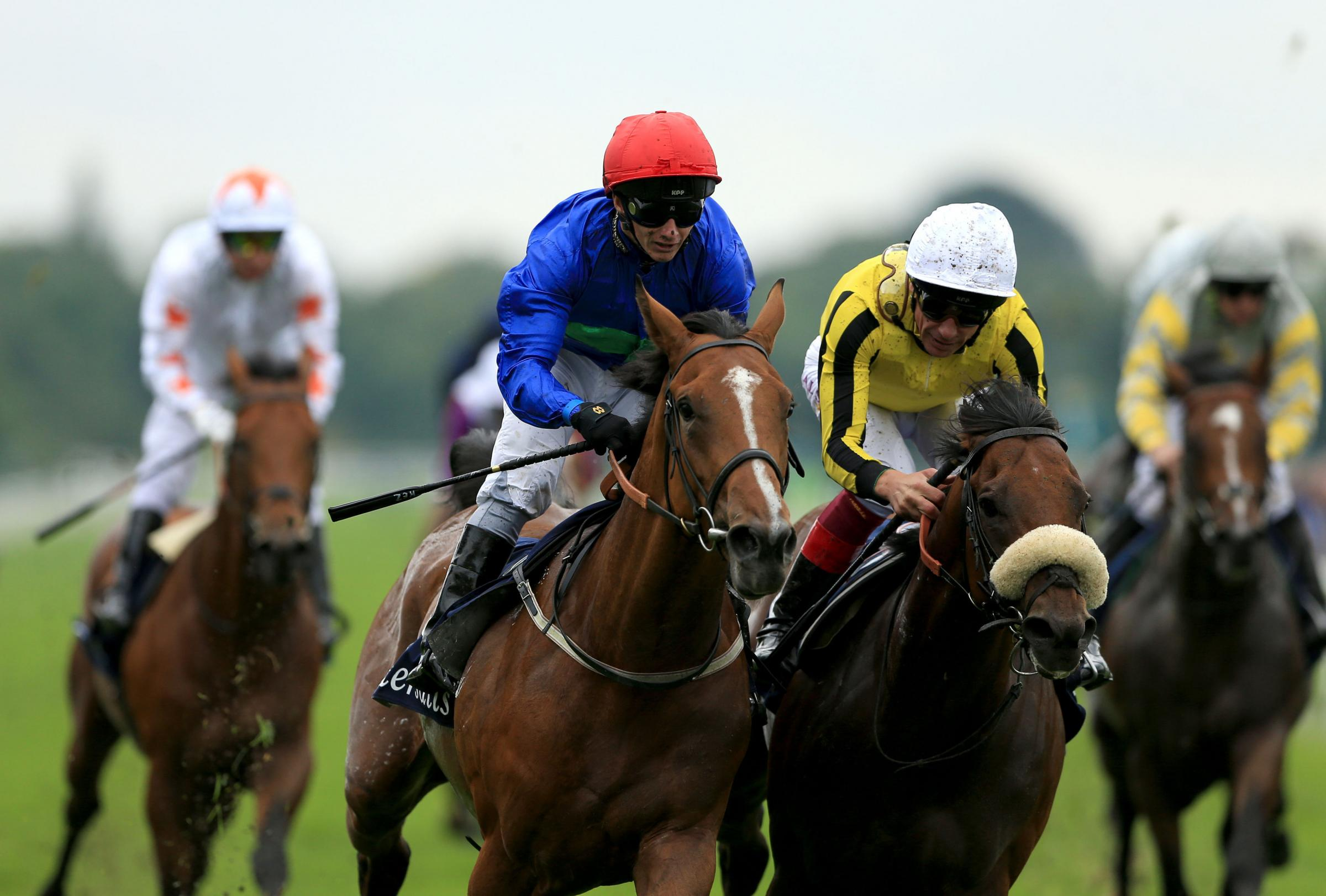 GO FOR GLORY: Wells Farhh Go, left, ridden by David Allan, wins the Tattersalls Acomb Stakes ahead of James Garfield ridden by Frankie Dettori during the Juddmonte International Day of the Yorkshire Ebor Festival at York last August. Picture: Tim Goode/PA