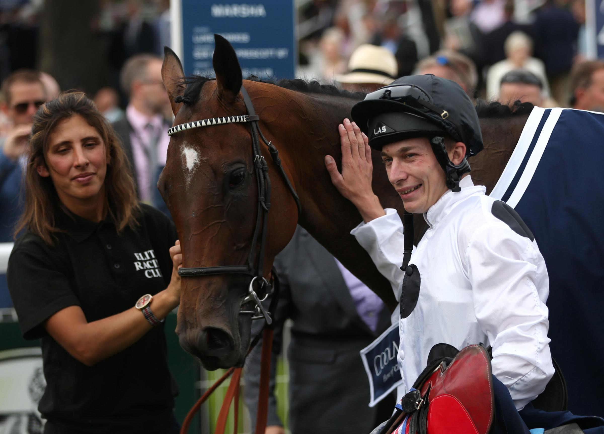 Luke Morris celebrates winning The Coolmore Nunthorpe Stakes on Marsha during day three of the 2017 Ebor Festival at York Racecourse