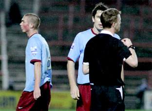 York City defender David McGurk pleads with referee Russell Fletcher after substitute  Richard Brodie, left, is sent off