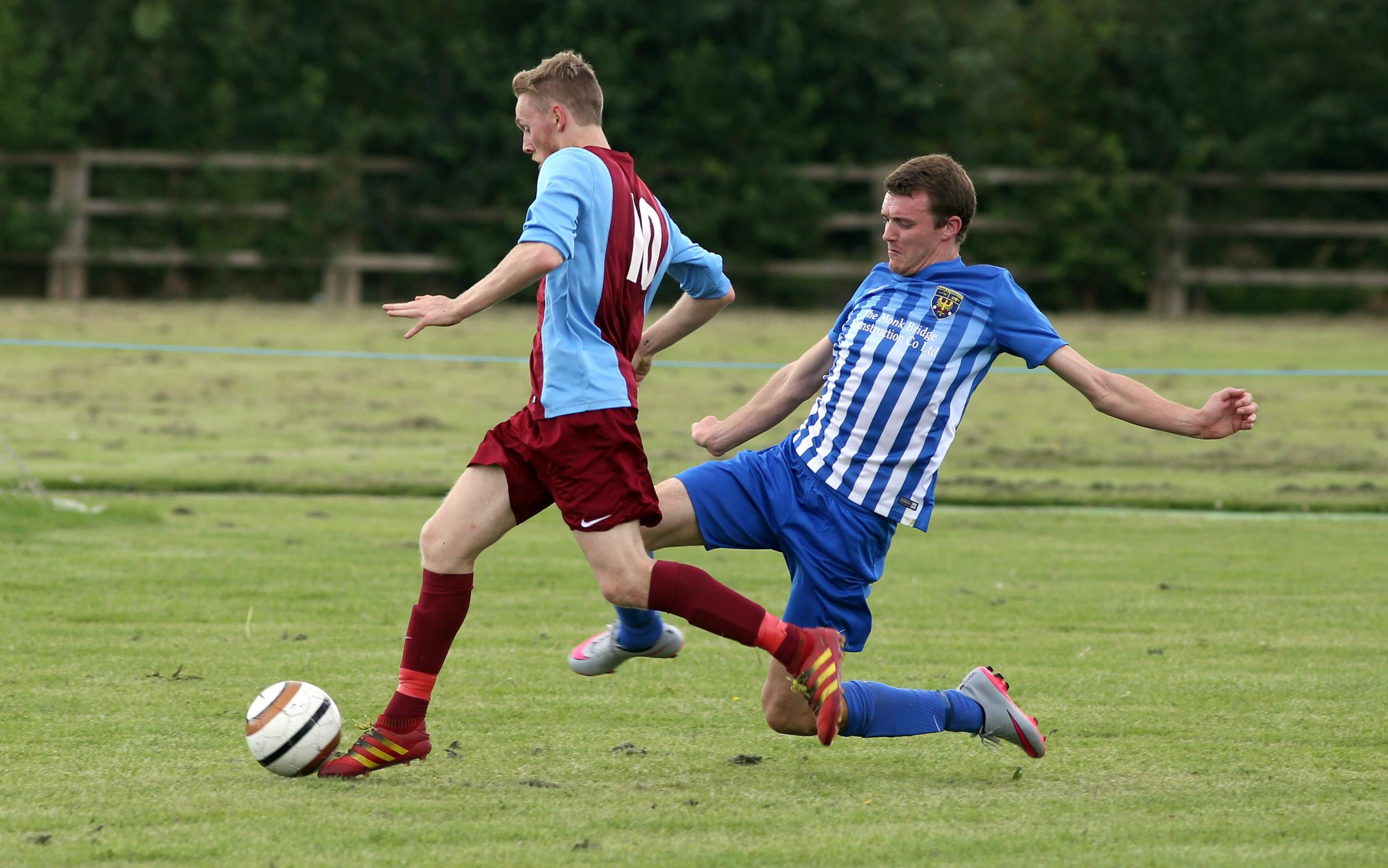 Dringhouses' Liam Robertson evades a tackle from Malton & Norton's Liam Preston. Picture: Richard Doughty Photography.