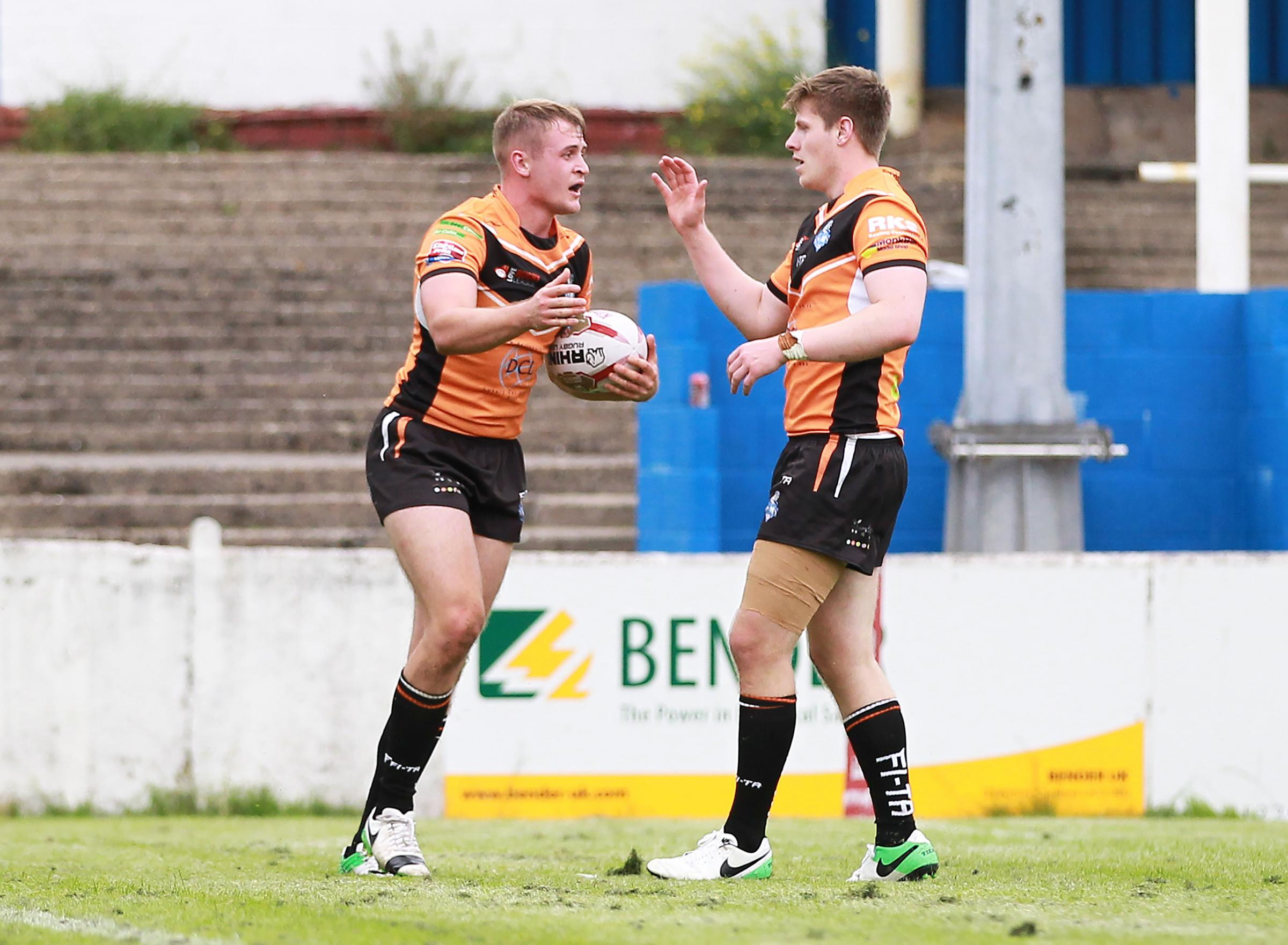 AUGUST STAR: Brad Hey, left, is congratulated by Ben Dent after scoring in York City Knights' match at Barrow Raiders last month. Picture: Gordon Clayton