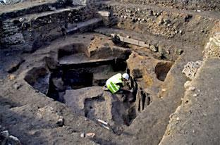 York Press: Gary Millward works on timbers forming part of the cellar of a Viking house found on the Hungate development.