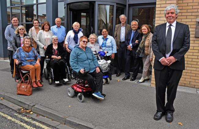 MEETING: John Kidney with sufferer of primary orthostatic tremor outside Hotel 53 in Piccadilly, York. Picture: Nigel Holland