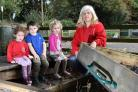 Julie Morris and children at Bishopthorpe Pre-School Playgroup with the vandalised sand pit. Picture: Frank Dwyer