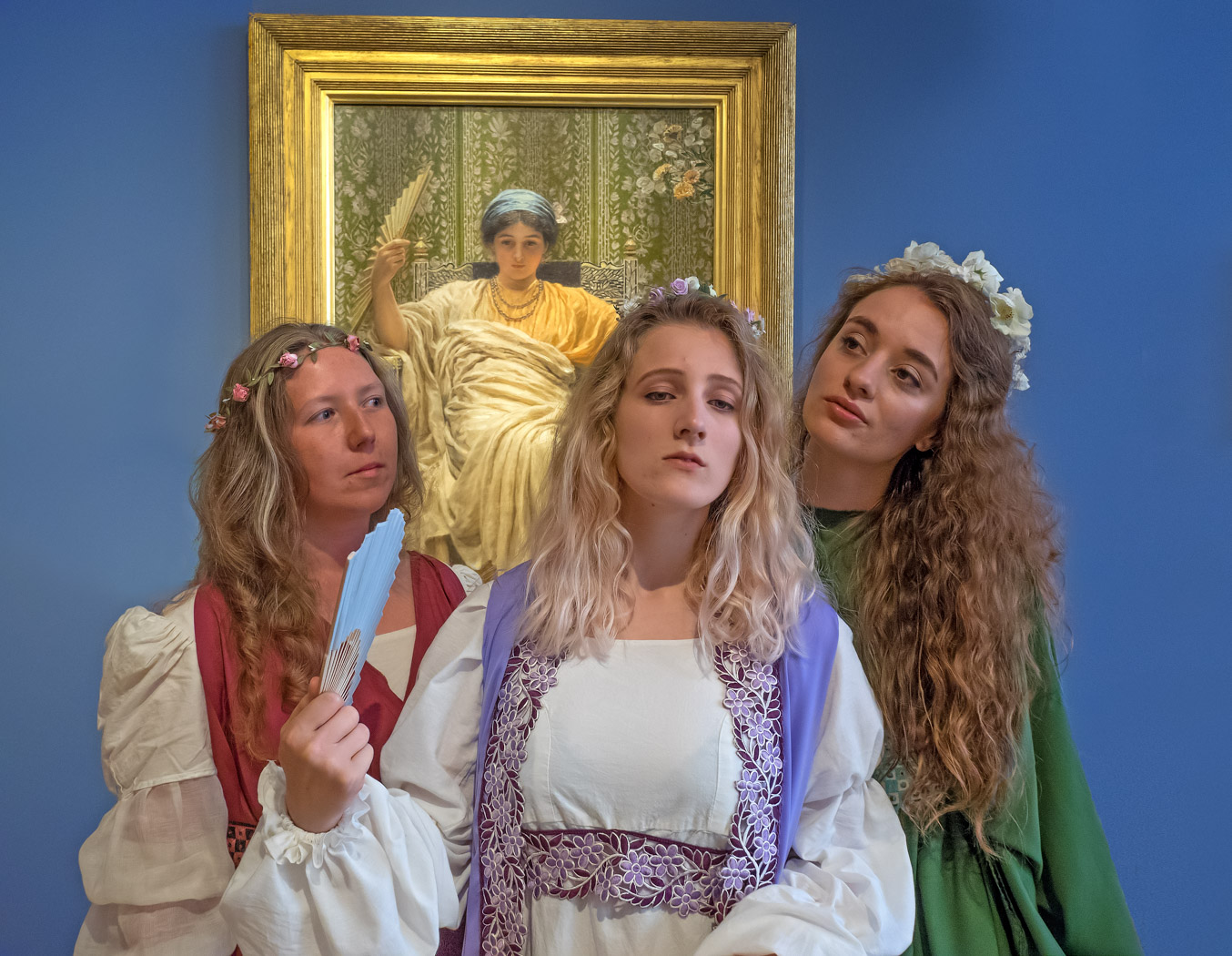 Ellie McCarthy, left, Jenny Jones and Annabelle Gipp, Aesthetic maidens in York Opera's chorus for Patience, pose in front of Aesthetic artist Albert Moore's painting A Reverie at York Art Gallery. Picture: John Saunders by kind permission of York Museums