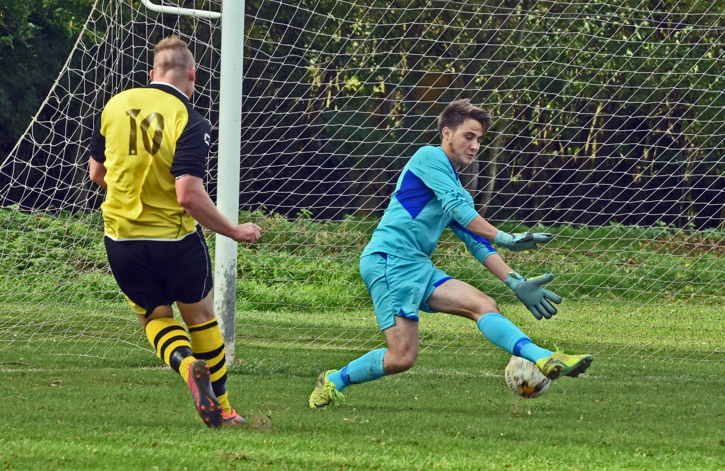 Rufforth striker Danny Cates scores the first goal in the game against Bubwith.Pic Nigel Holland.