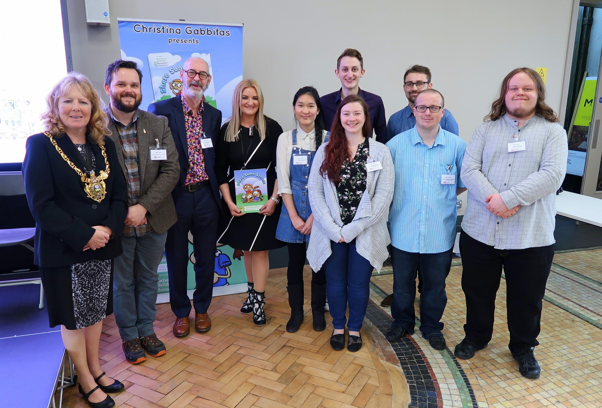 ANIMATED: Christina Gabbitas (centre, holding book), with the team from Sheffield Hallam University and the Lord Mayor of Sheffield at the animation launch.
