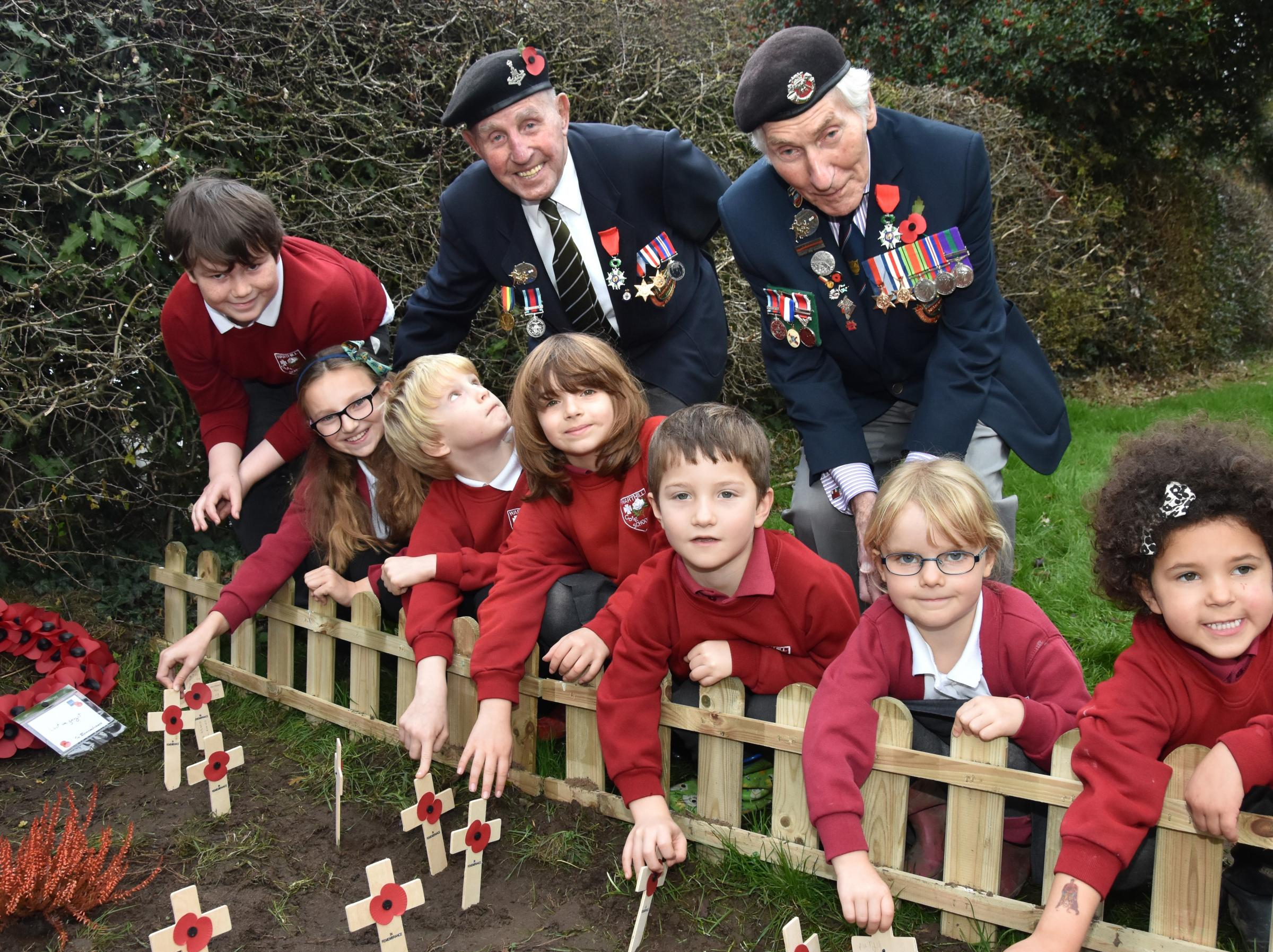 LEST WE FORGET: Warthill Primary School's  Remembrance Service with Normandy Veterans, from left, Ken Cooke and Ken Smith  Picture: Frank Dwyer