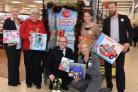Major Andrew Dunkinson is pictured (centre) receiving gifts from Tesco staff and managers (left to right) Laura Rodmell, Brenda Wardle, Hannah Shannon, Lisa Ingham and Ben Tolkin.