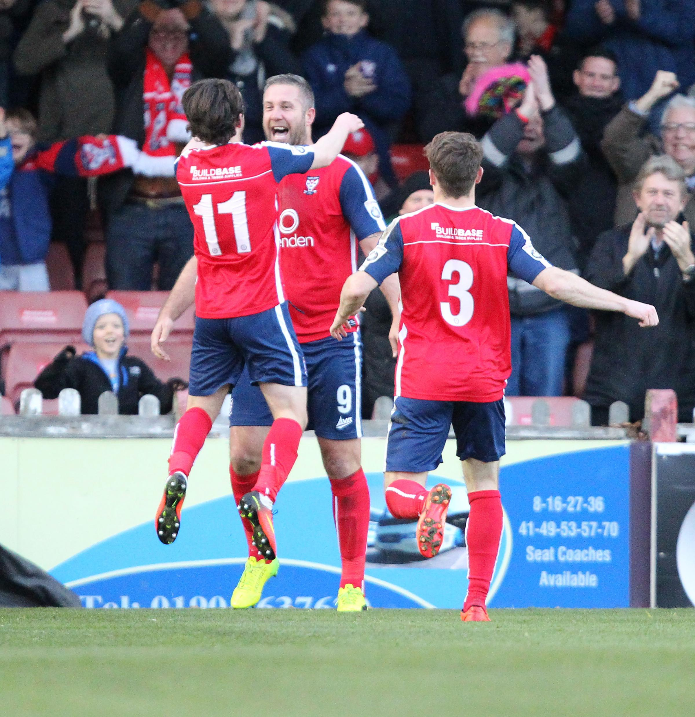 JUMP IN STANDARD: Aidan Connolly congratulates Jon Parkin on his goal against a Kidderminster side that York City boss Martin Gray described as the National League North's best footballing team. Picture: Gordon Clayton