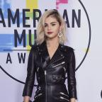 York Press: Selena Gomez arrives at the American Music Awards (Jordan Strauss/Invision/AP)